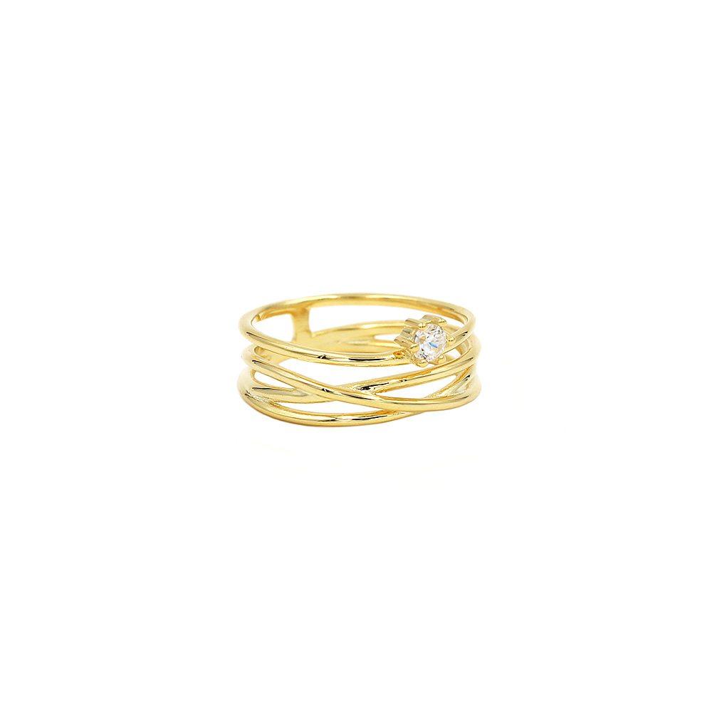 anillo satélite con baño de oro de 18kt y circonita blanca